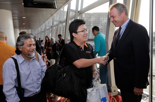 Malaysia Airlines CEO greeting passengers on the first day of the new company Pic credit: NSTP/Aizuddin Saad