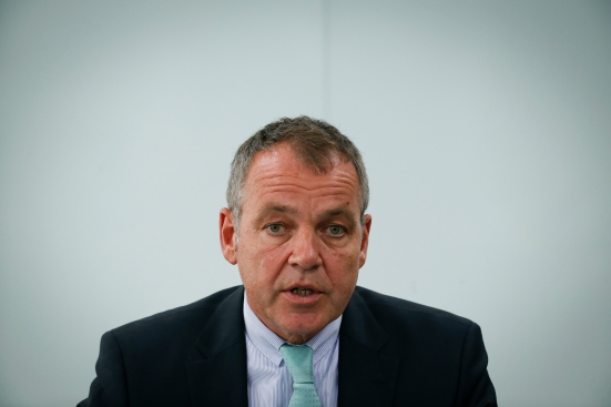 The strain is evident on the face of Malaysia Airlines CEO Christoph Mueller